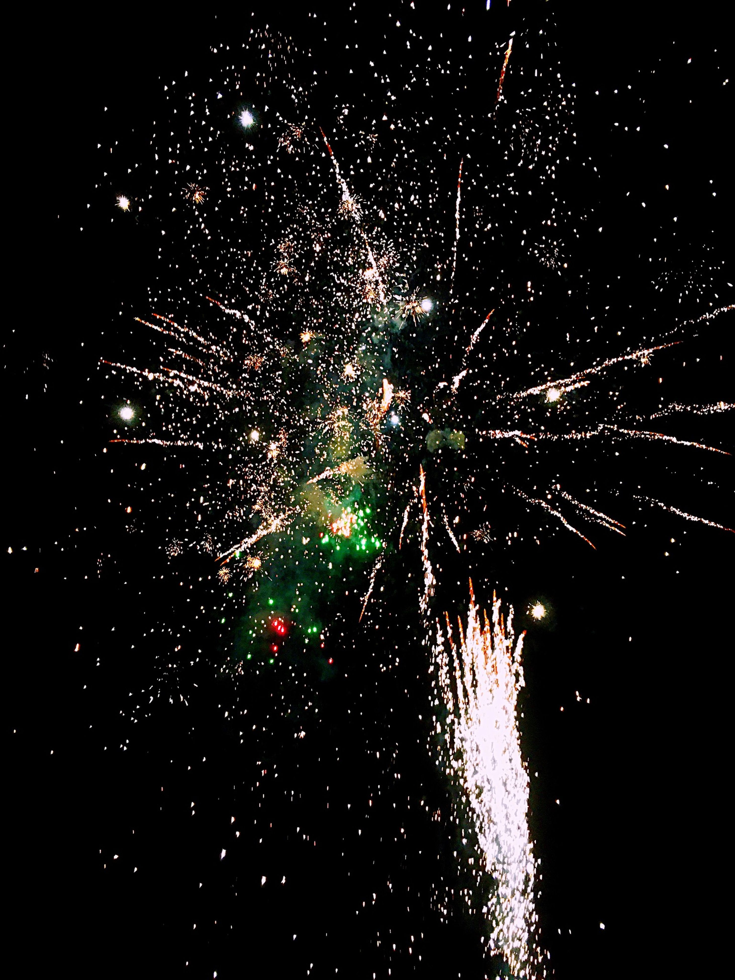 night, illuminated, firework display, long exposure, celebration, firework - man made object, exploding, sparks, motion, glowing, firework, arts culture and entertainment, event, low angle view, blurred motion, entertainment, sky, celebration event, light, outdoors