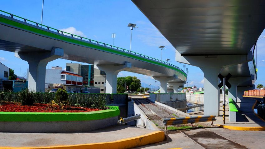 Architecture Bridge - Man Made Structure Built Structure City Day Green Color Lightday Nature No People Outdoors Rails Sunlight Sunrise The City Light