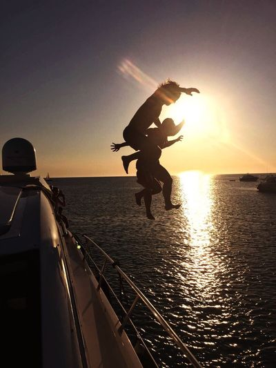 Sea Sunset Silhouette Water Full Length Horizon Over Water Sky Outdoors Sun Sunlight Men Leisure Activity Nautical Vessel Scenics Nature Jumping Lifestyles One Person Day Silhouette Formentera