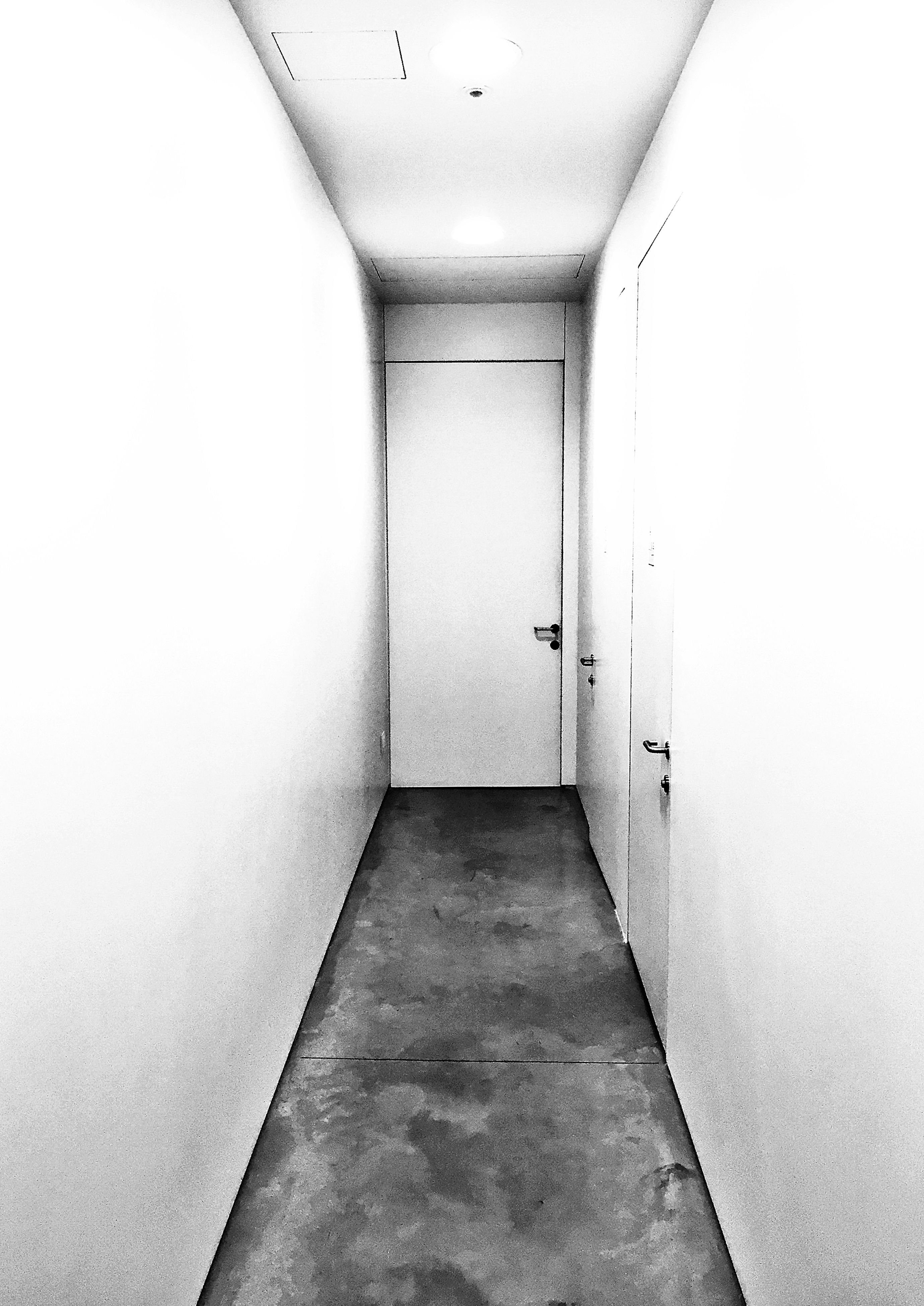indoors, the way forward, architecture, corridor, built structure, diminishing perspective, wall - building feature, empty, ceiling, vanishing point, wall, absence, building, no people, lighting equipment, narrow, flooring, copy space, day, tiled floor