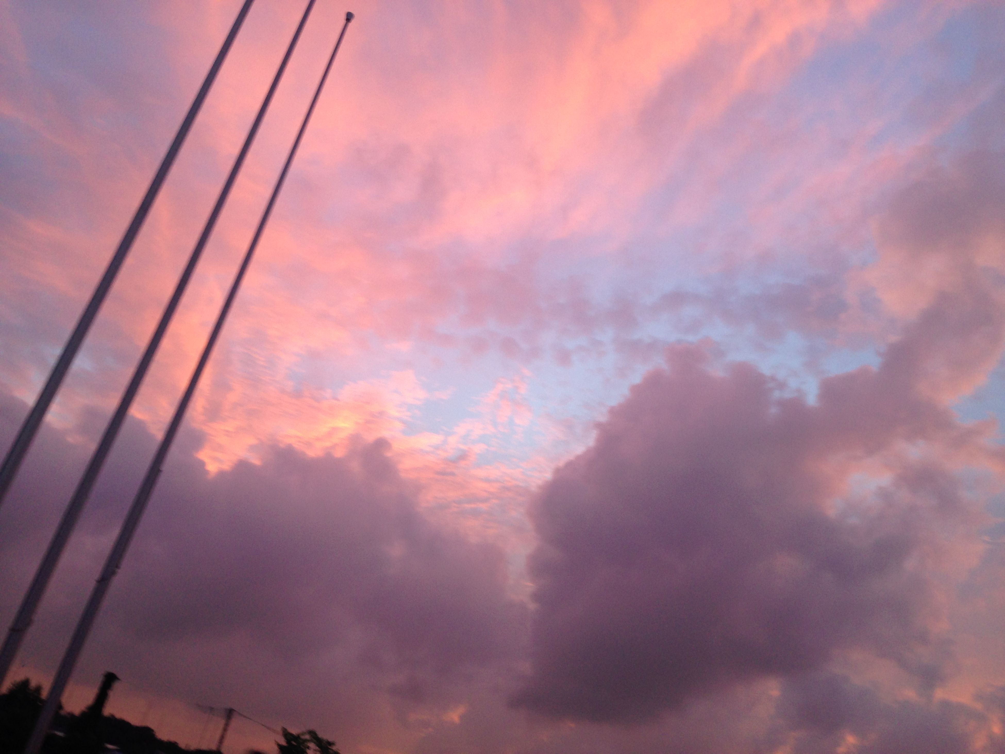 low angle view, sky, sunset, cloud - sky, cloudy, silhouette, beauty in nature, orange color, cloud, scenics, power line, dramatic sky, nature, weather, tranquility, connection, overcast, cloudscape, dusk, electricity