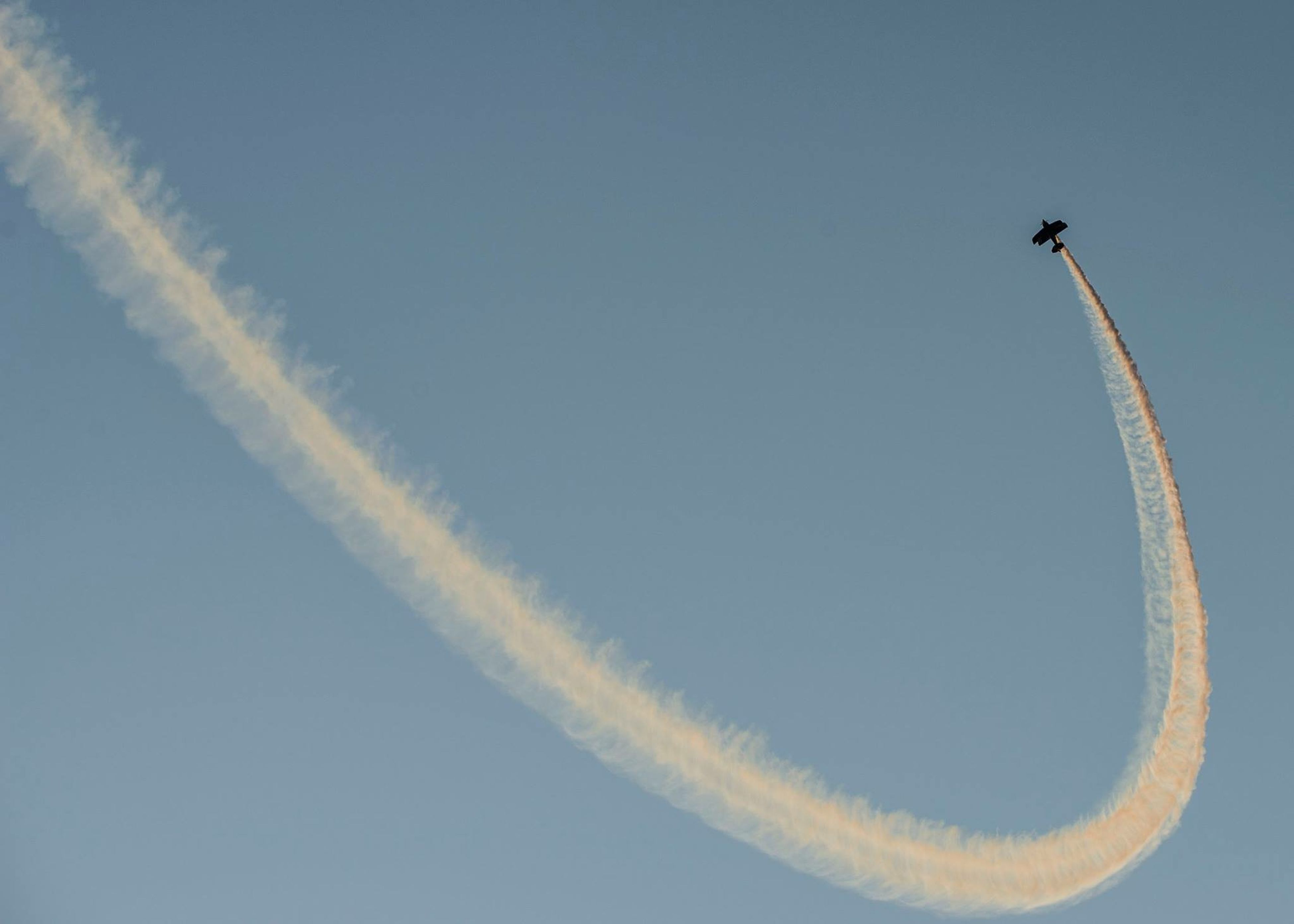 clear sky, copy space, low angle view, blue, sky, nature, motion, flying, no people, day, outdoors, speed, part of, beauty in nature, mid-air, close-up, vapor trail, tranquility, cropped, white color