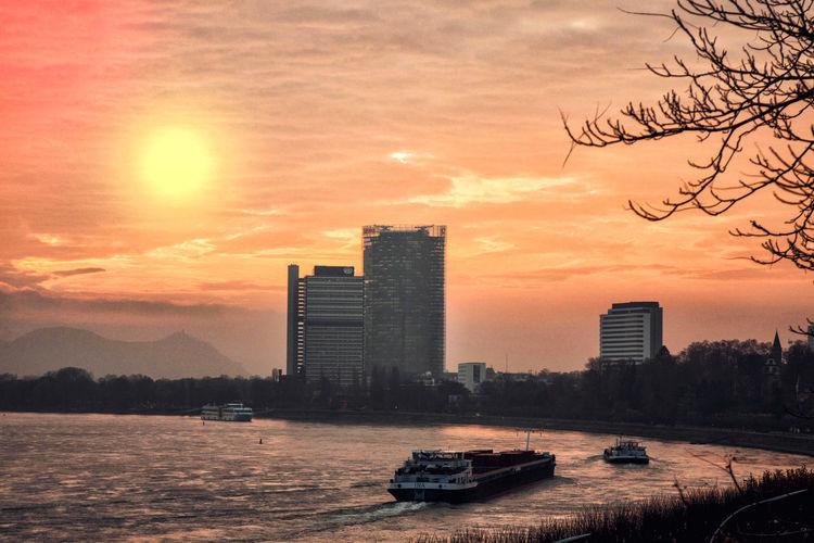 Morgens am Rhein in Bonn Bonn Posttower Rhein Architecture Building Exterior City Cityscape Growth Langer Eugen Modern No People Outdoors Sky Skyscraper Sun Sunset Urban Urban Skyline