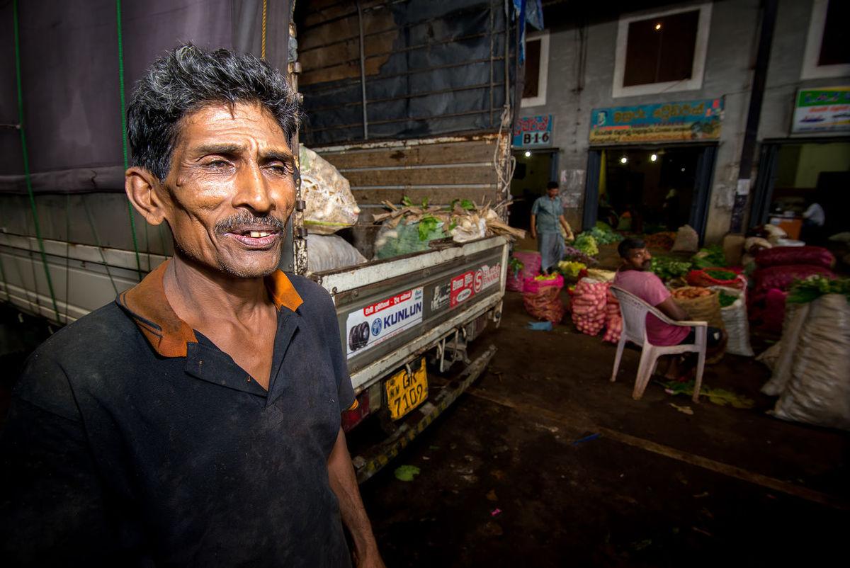 Dambulla market in Sri Lanka is the biggest food market on island Buy Casual Clothing Dambulla Farmer Farmers Market Fruits Heavy Illuminated Lifestyles Market Portrait Sell Seller Shop Sri Lanka Store Vegetables