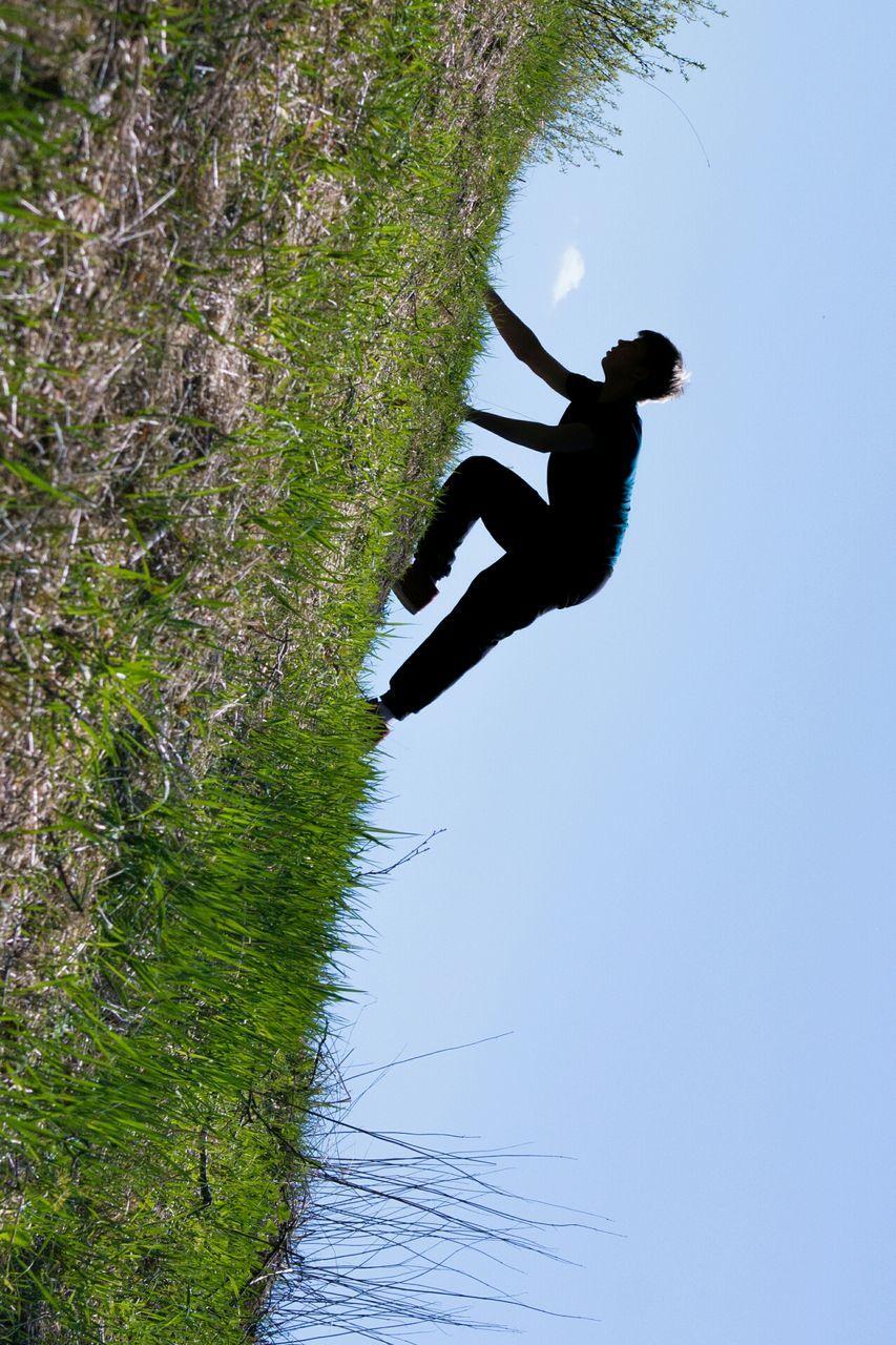 Side view of a man on slope landscape against sky