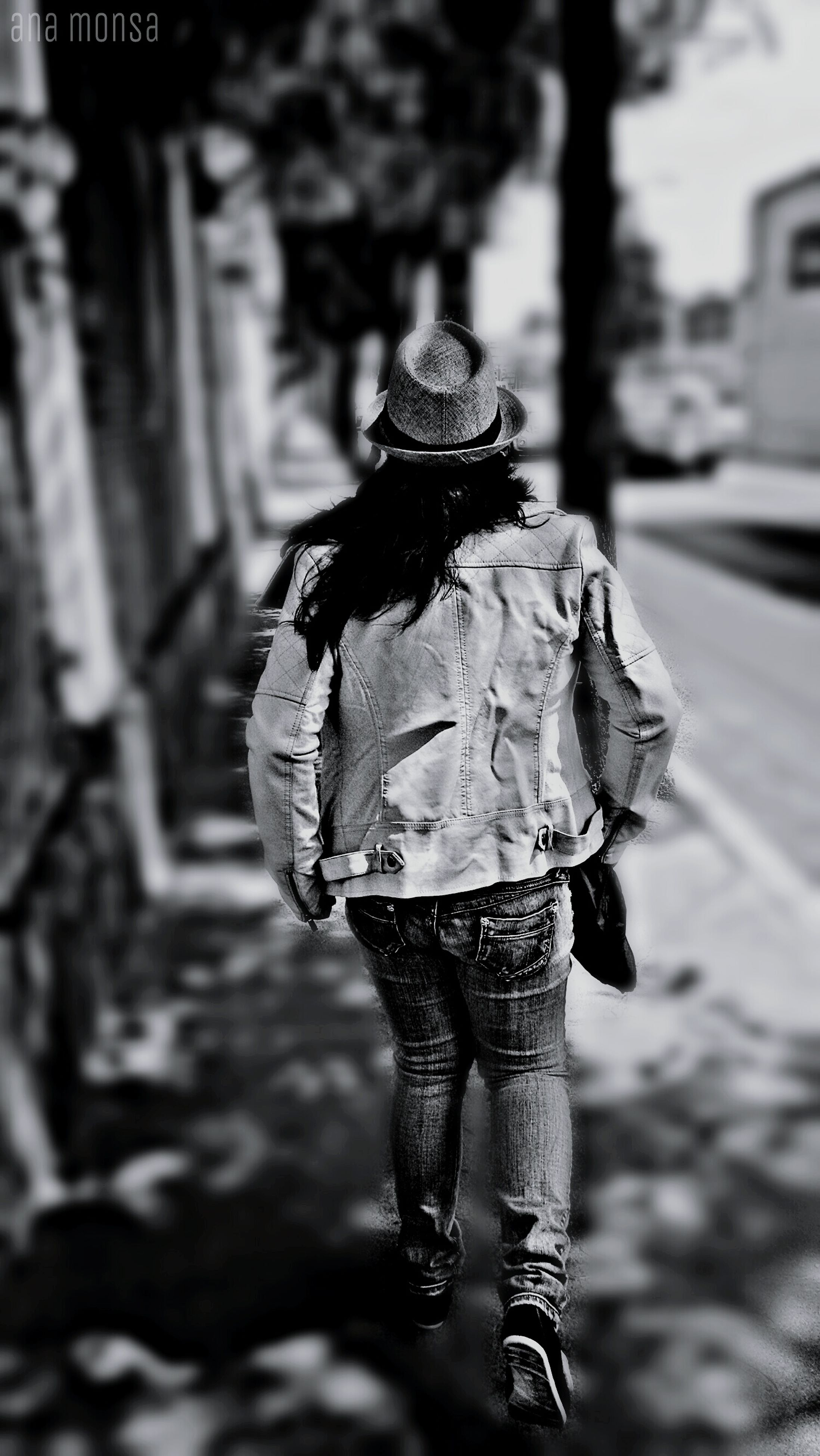 focus on foreground, street, rear view, lifestyles, walking, holding, casual clothing, person, leisure activity, full length, incidental people, standing, men, outdoors, day, road, selective focus, sidewalk