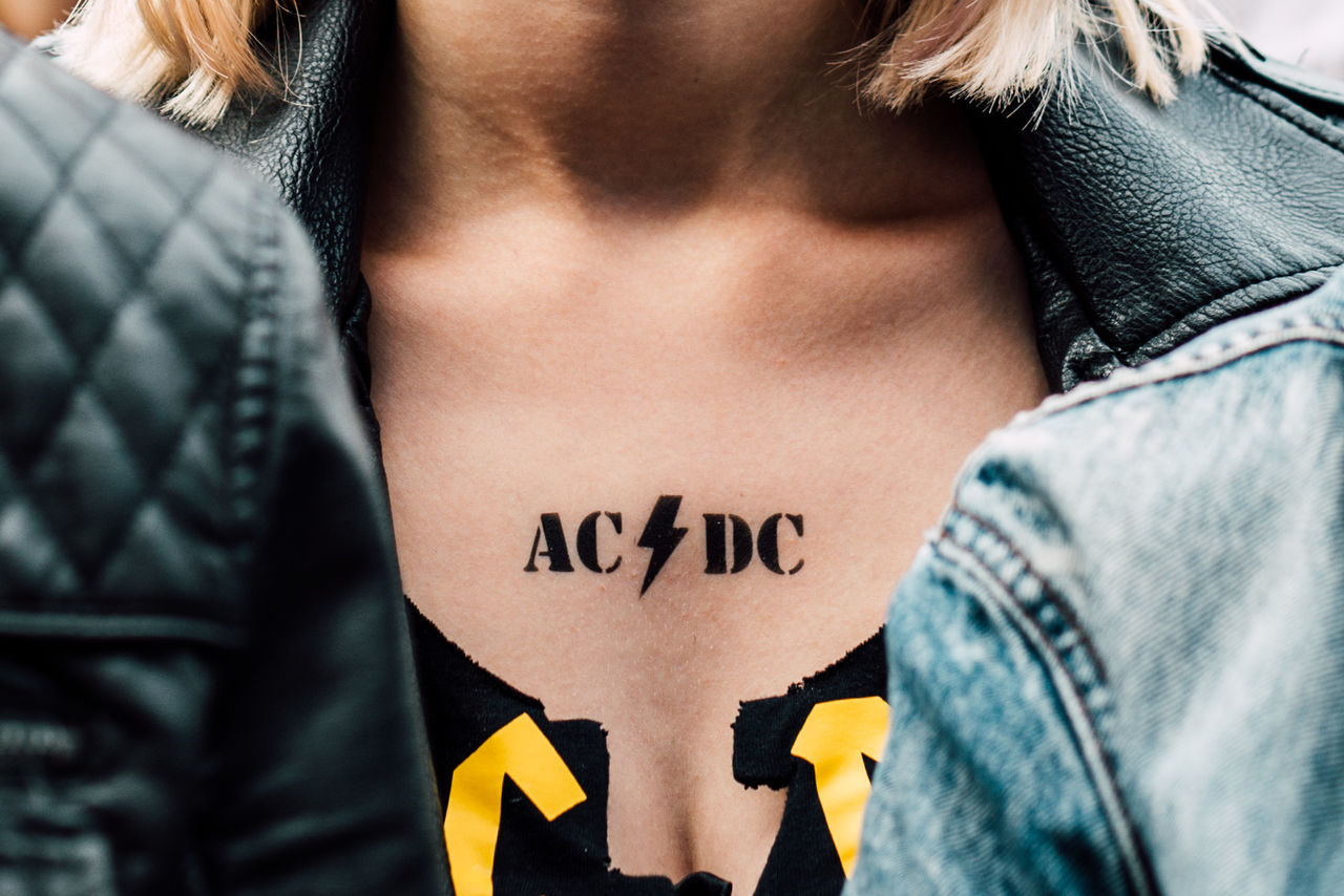 ACDC Casual Clothing Close-up Communication Concert Day Midsection Music One Person People Real People Standing Text
