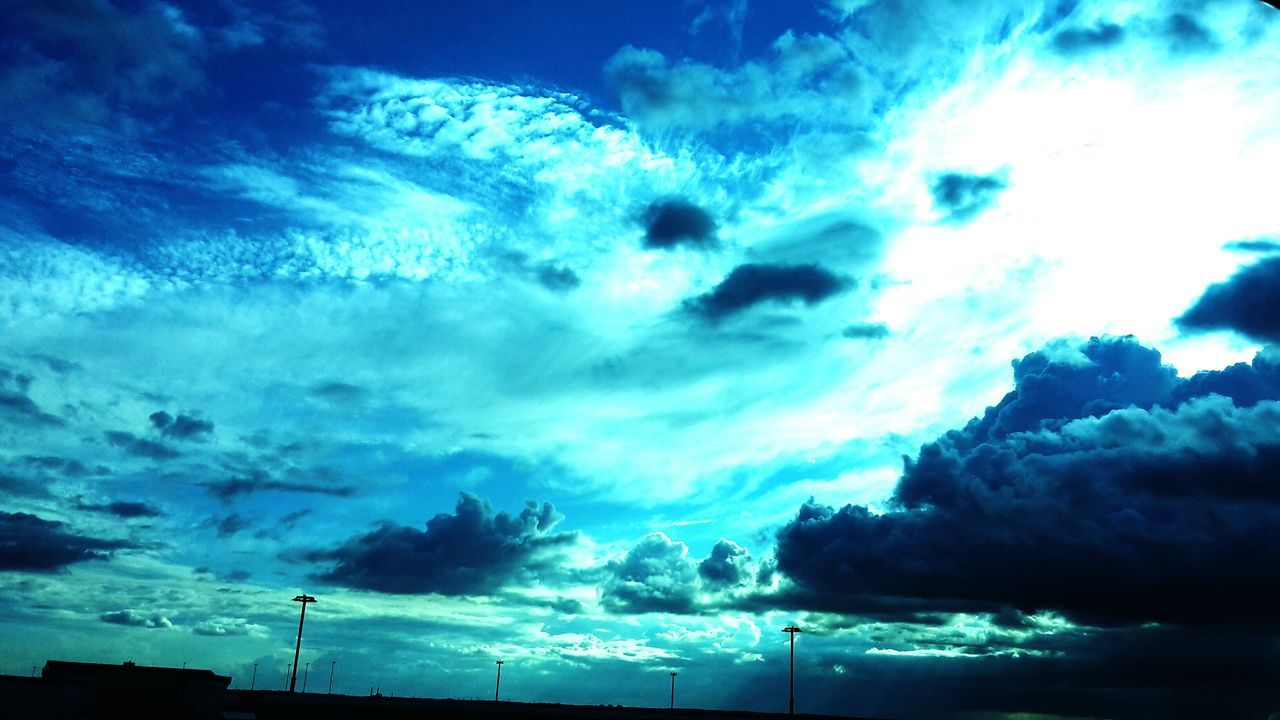 cloud - sky, sky, low angle view, silhouette, beauty in nature, nature, no people, scenics, tranquility, outdoors, blue, technology, day