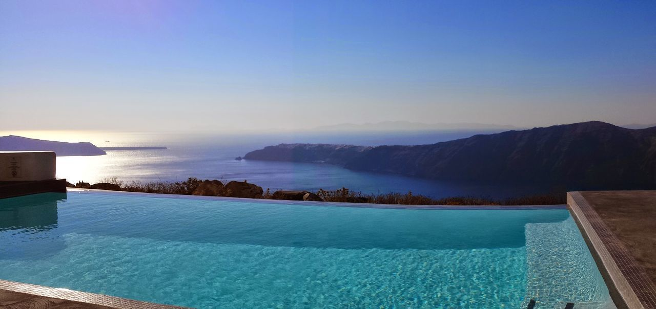 View on the Caldera Santorini Greece Seascape Sky Pool Poolside Infinity Pool Luxury Lifestyle Calmness No People Unfiltered Unforgettable Taking Photos Blue Blue Sky Green Hues Cyclades Islands Summer View From Above Samsungphotography Colour Of Life