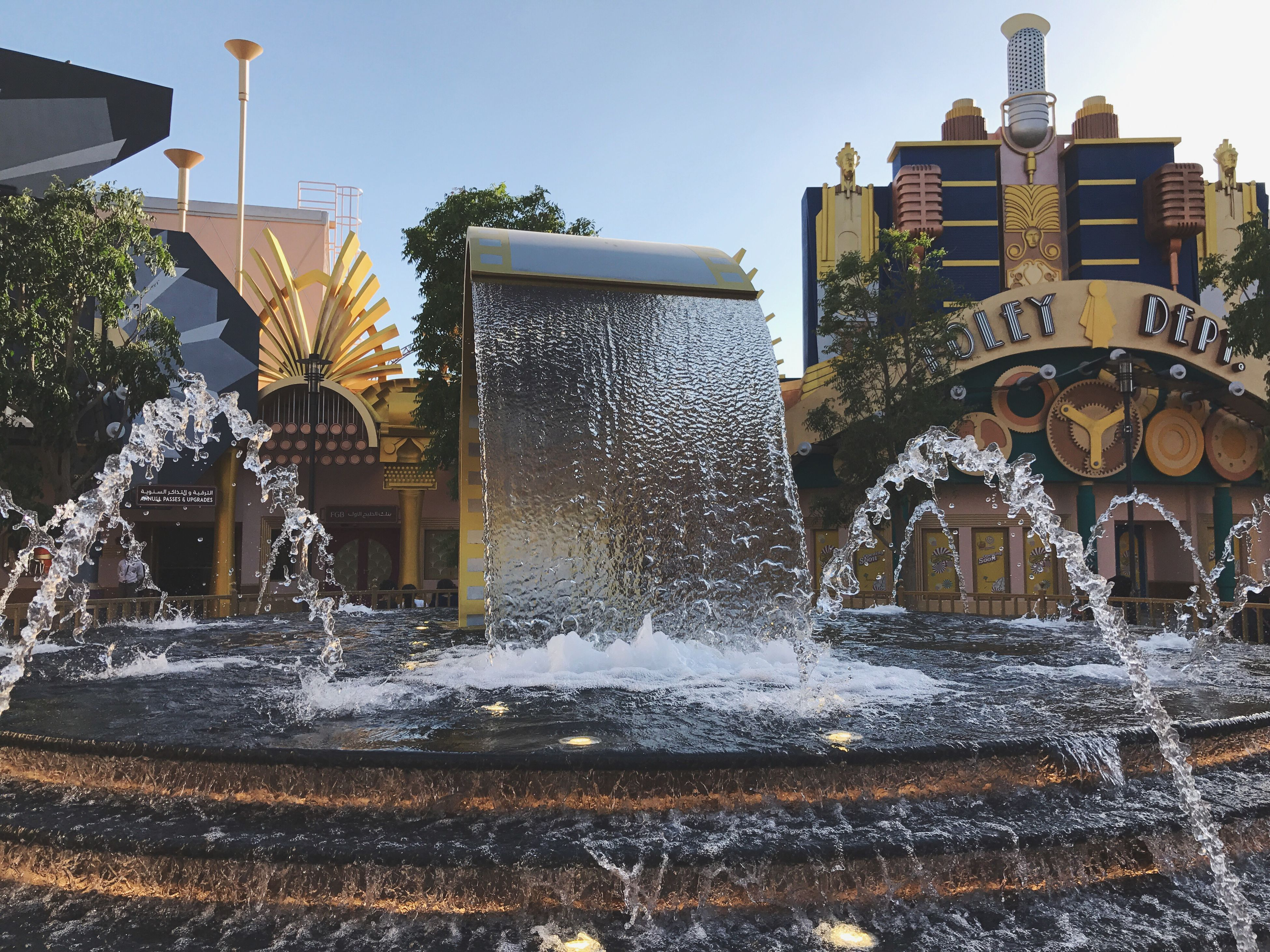 water, motion, splashing, fountain, spraying, architecture, long exposure, building exterior, outdoors, built structure, no people, waterfall, blurred motion, day, drinking fountain, nature, city, sky