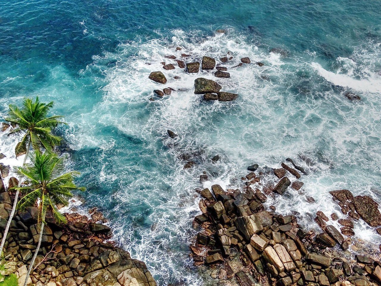sea, rock - object, water, wave, nature, motion, beauty in nature, no people, high angle view, day, outdoors, breaking, beach, crash