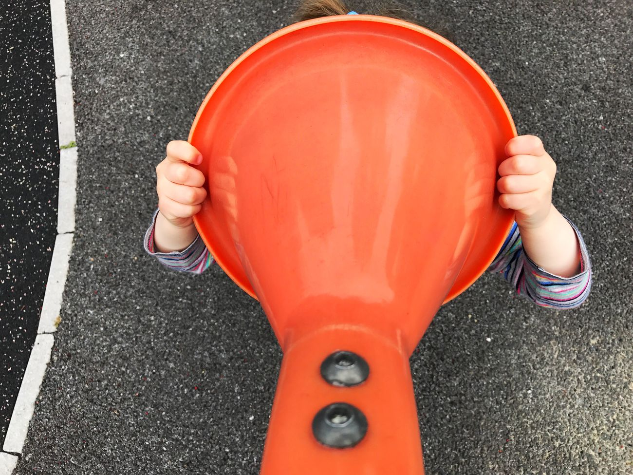 Child playing with megaphone at a playground High Angle View One Person Road Day Human Body Part Real People Close-up Outdoors Human Hand Megaphone Leisure Activity Playground Childhood Child Cry For Help Kids Kids Being Kids Communication EyeEm Selects People