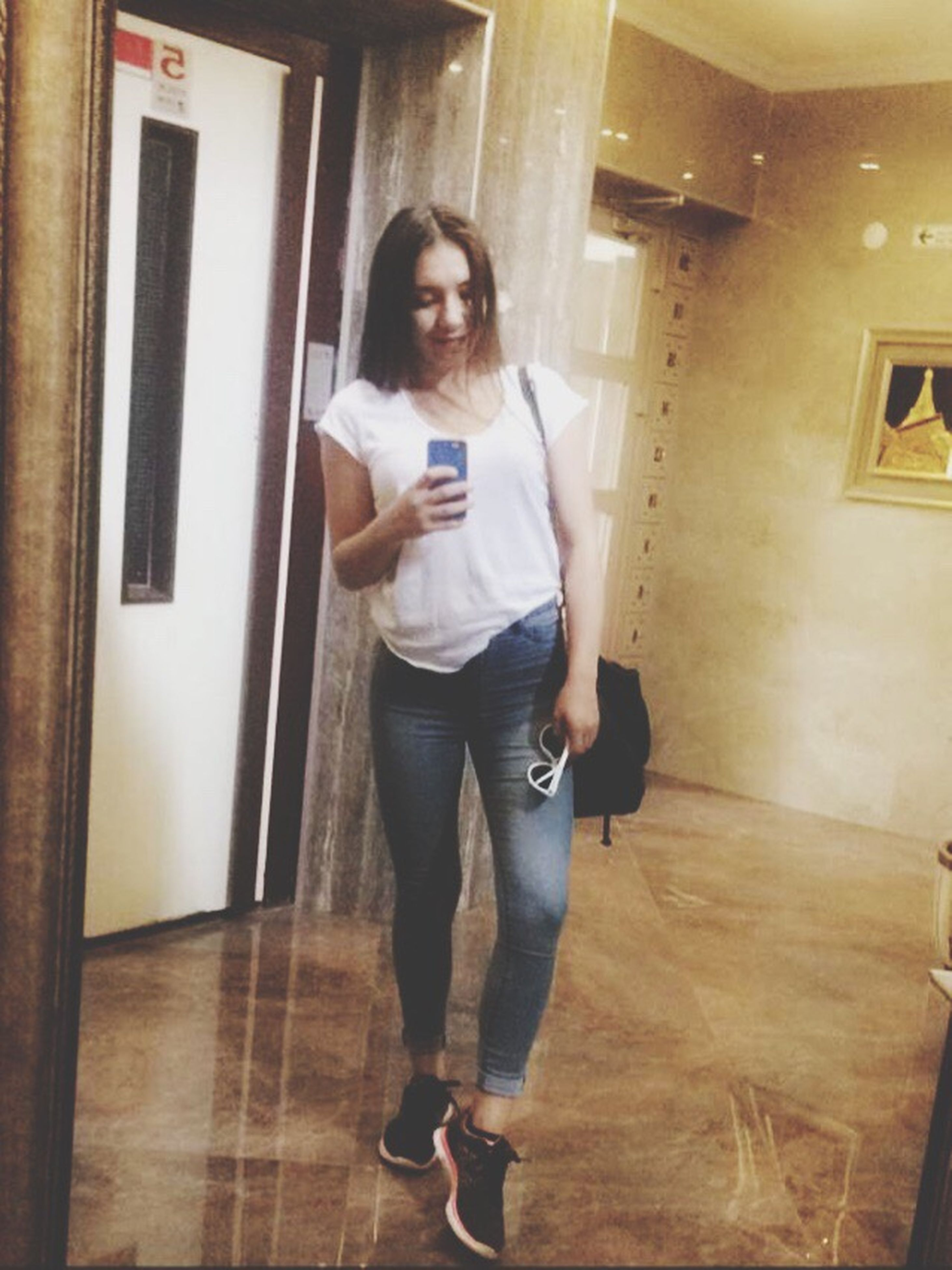 indoors, full length, person, lifestyles, casual clothing, leisure activity, young adult, standing, front view, three quarter length, home interior, childhood, door, elementary age, looking at camera, holding, portrait, boys
