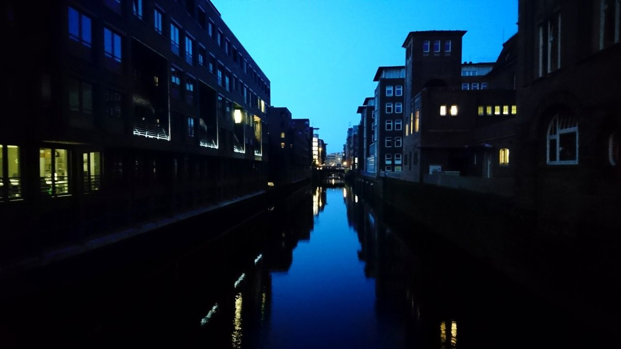 architecture, built structure, building exterior, illuminated, city, reflection, transportation, waterfront, night, outdoors, water, no people, sky, travel destinations, clear sky