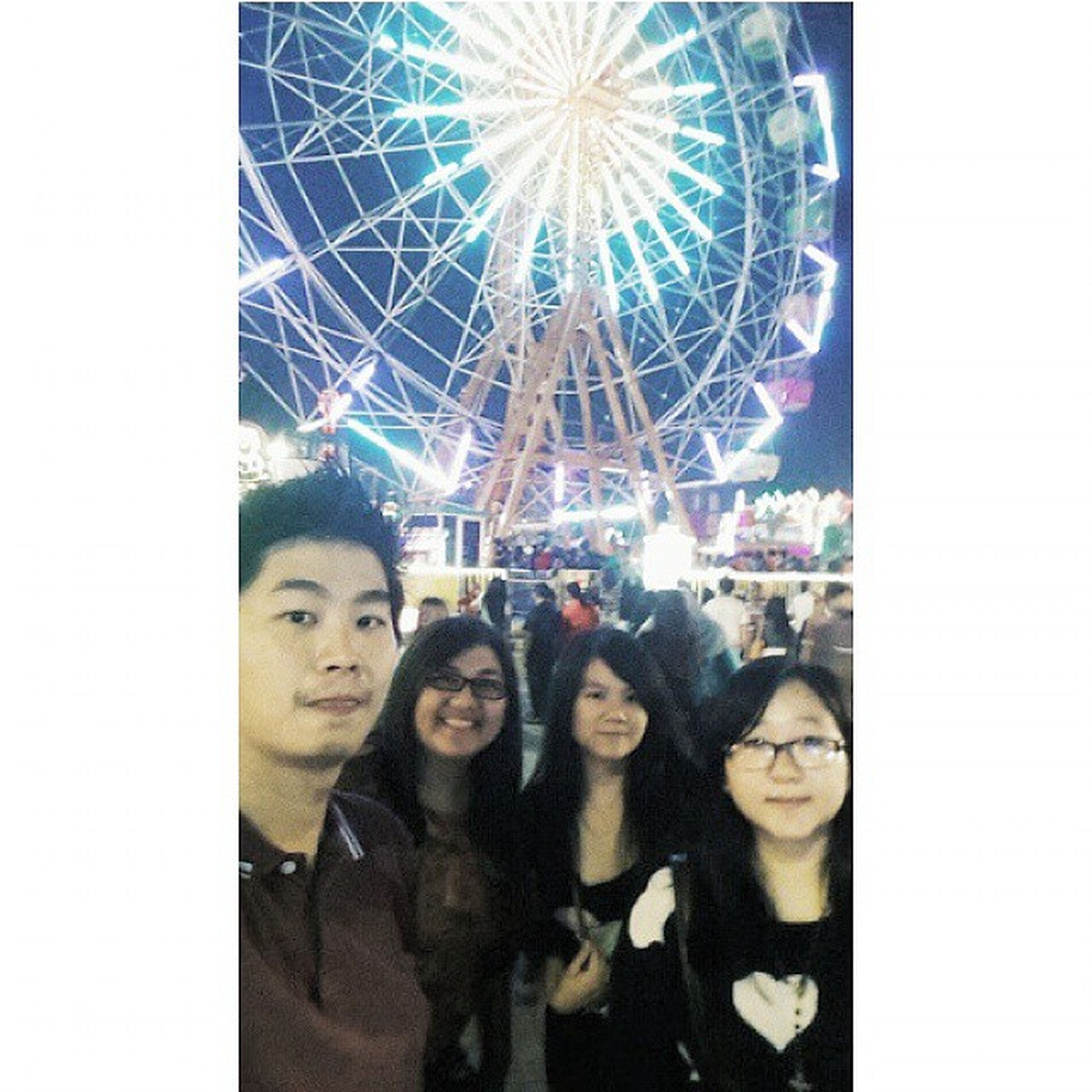 transfer print, lifestyles, leisure activity, arts culture and entertainment, fun, auto post production filter, enjoyment, indoors, amusement park, men, large group of people, person, standing, togetherness, amusement park ride, young adult, celebration, low angle view