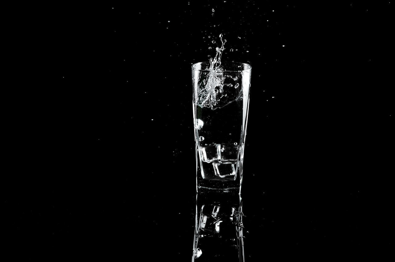 Black Background Close-up Cold Temperature Drink Drop Freshness Motion No People Refreshment Studio Shot Water