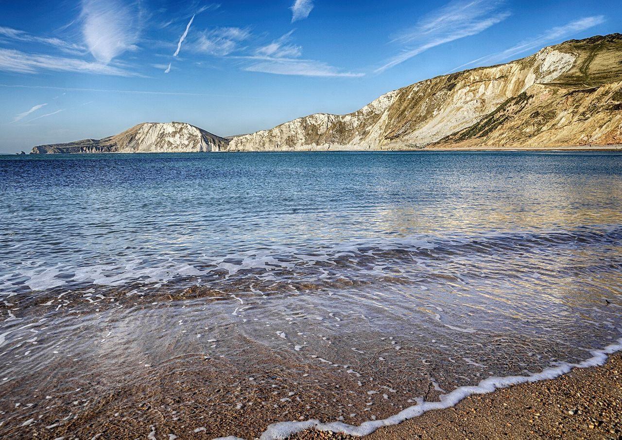 Worbarrow Bay Beauty In Nature Nature Scenics Tranquility Water Sea Outdoors Tranquil Scene Mountain Beach No People Sky Day Wave