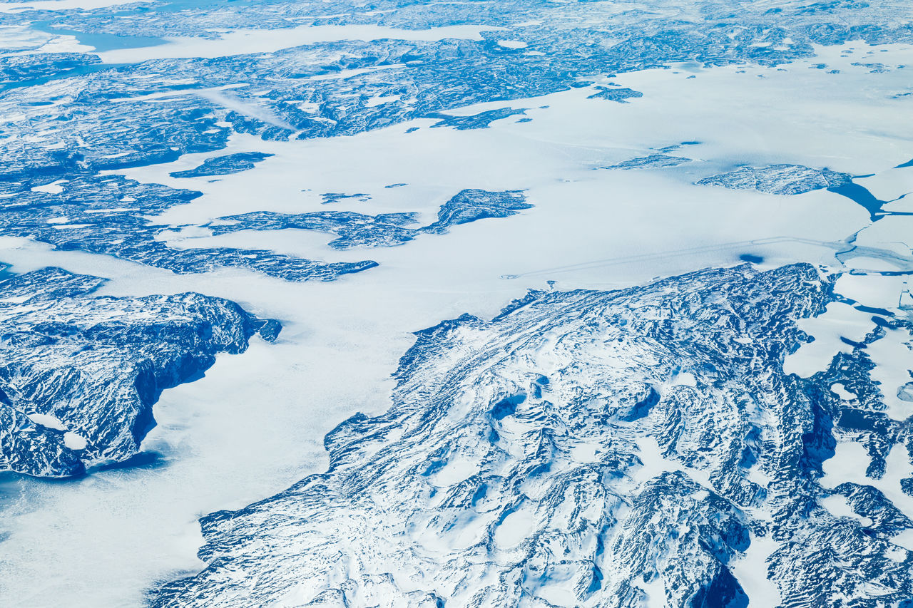 beauty in nature, aerial view, cold temperature, nature, scenics, snow, white color, no people, tranquility, winter, tranquil scene, high angle view, landscape, outdoors, day, ice, mountain, physical geography, frozen, backgrounds, snowcapped mountain, water