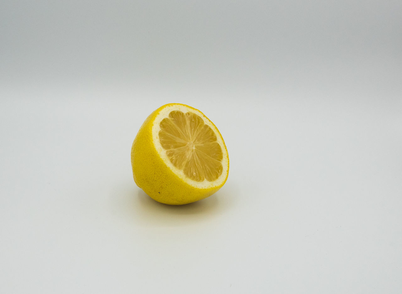Citrus Fruit Close-up Copy Space Cross Section Day Food Food And Drink Freshness Fruit Healthy Eating Indoors  Lemon Lime No People Nutritional Supplement SLICE Sour Taste Studio Shot White Background Yellow