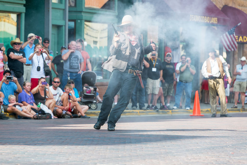 DEADWOOD, SD - AUGUST 26: Reenactment of a gunfight in Deadwood, SD on August 26, 2015 Actors Architecture Bar Black Hills Brick Casino Deadwood  Downtown Gunfight Historic Hotel Old West  Reenactment Restaurant Smoke South Dakota Tavern  Tourism Tourists Town Travel Travel Destinations USA Western Wild West
