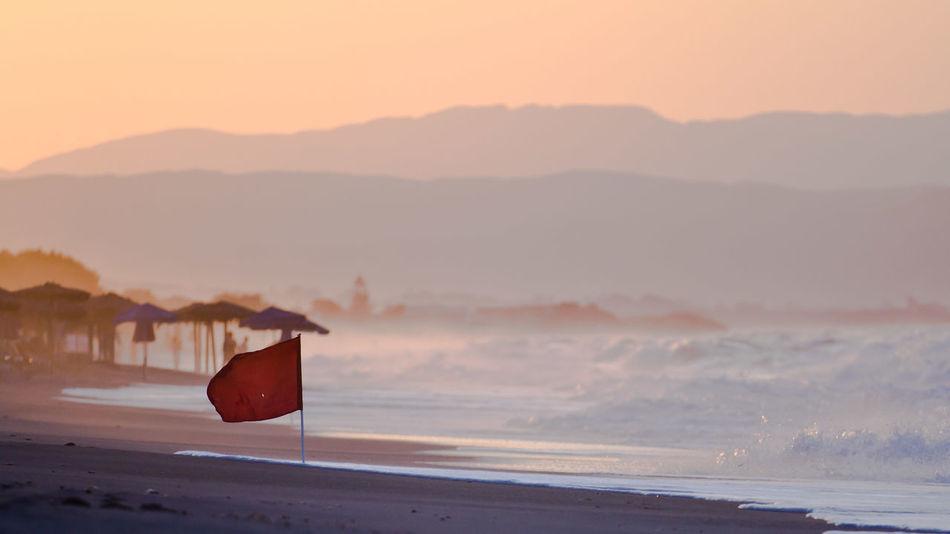 Beautiful stock photos of flag, Beach, Beauty In Nature, Coastline, Communication