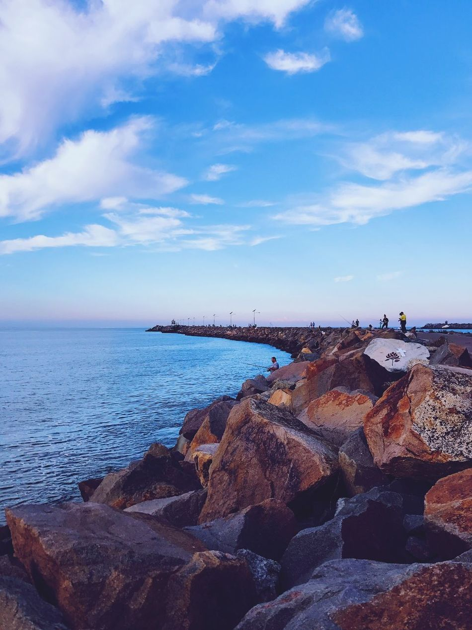 Sea Sky Water Nature Rock - Object Cloud - Sky Tranquility EyeEmNewInHere Horizon Over Water Beauty In Nature Scenics Outdoors Day No People Groyne Pebble Beach Beach Life EyeEmNewHere. Sunset Dusk Fishing Art Is Everywhere EyeEmNewHere