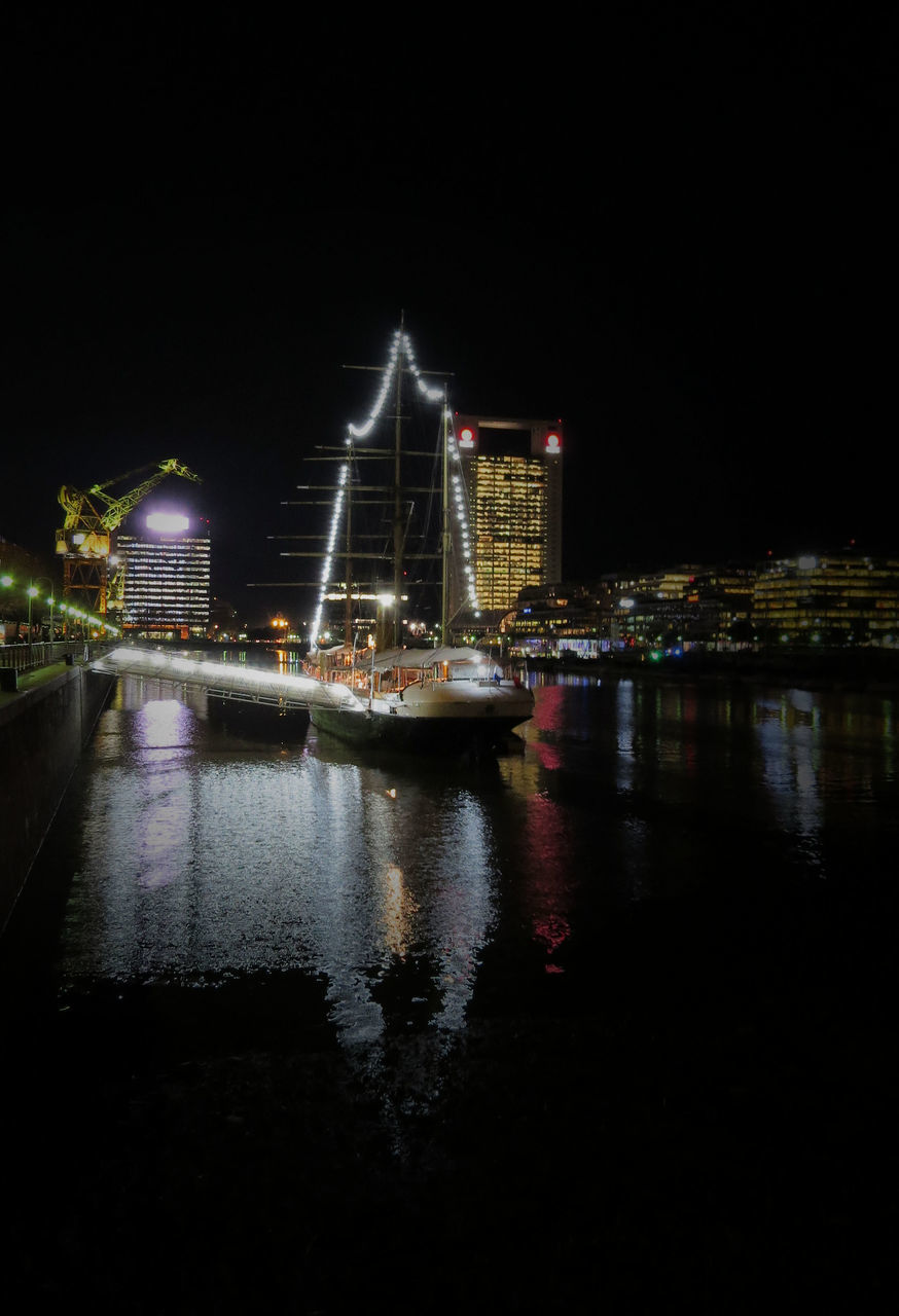 night, illuminated, water, architecture, waterfront, river, transportation, built structure, nautical vessel, no people, reflection, building exterior, bridge - man made structure, outdoors, travel destinations, city, sky, nature