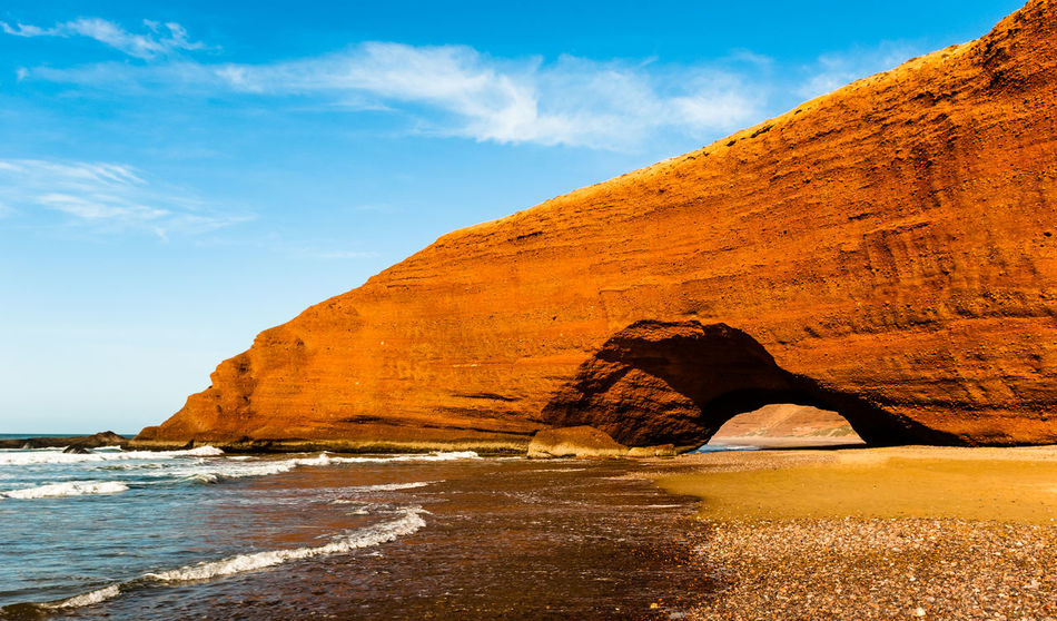 Legzira rocks Beach Beauty In Nature Blue Day Ecology Landscape Legzira Morocco Mountain Natural Arch Nature No People Ocean Outdoors Rock Rock - Object Sand Scenics Sea Sky Travel