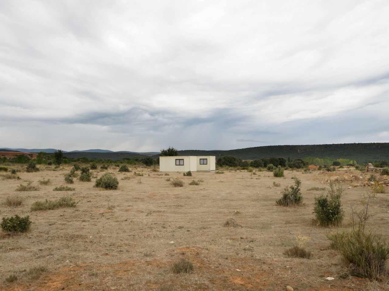 lonely bungalow in the wild on the Way Of Saint James / Camino De Santiago Accomodation Arid Climate Arid Landscape Bungalow Loneliness Lonely Pilgrimage Red Earth SPAIN Way Of Saint James