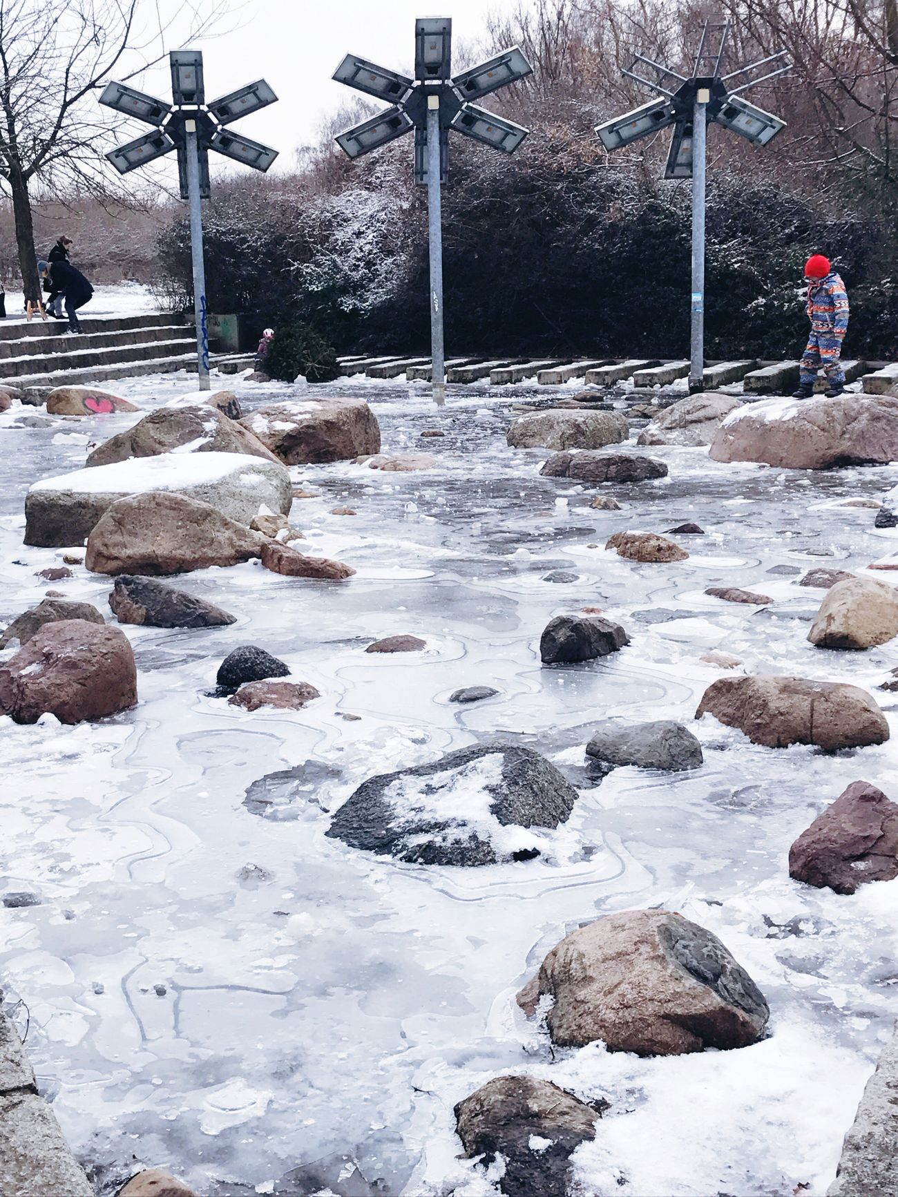 Cold Temperature Winter Frosty Looking Down Cold Days Ice Rocks In Water Frozen Kids Playing City Life
