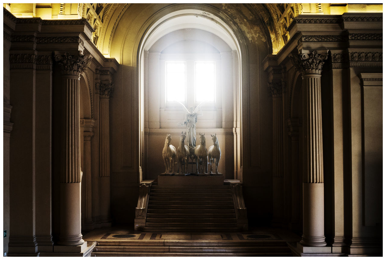 architectural column, indoors, religion, place of worship, spirituality, architecture, statue, pew, history, built structure, altar, sculpture, no people, day