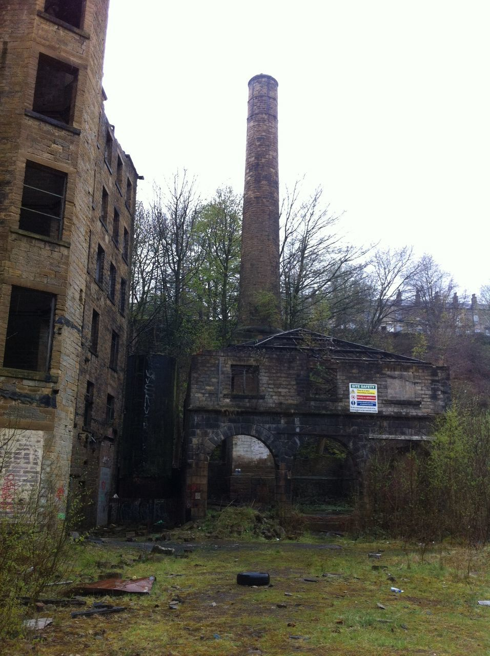 Smoke Stack In Abandoned Factory Against Sky