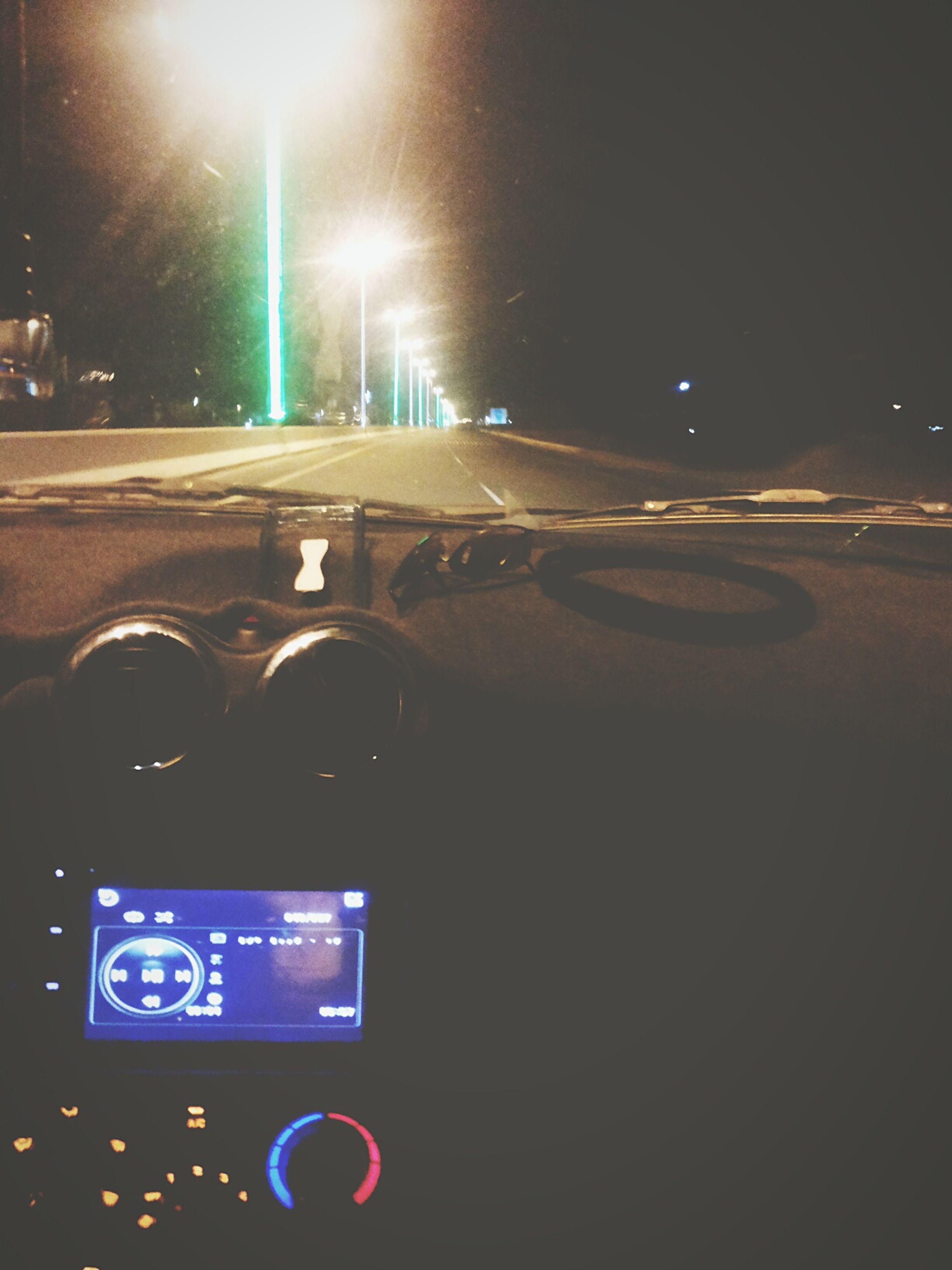 transportation, illuminated, night, car, land vehicle, mode of transport, road, street, traffic, street light, communication, on the move, lighting equipment, guidance, road marking, road sign, text, city street, headlight, speed