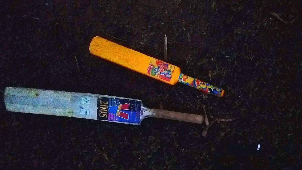 How Bat Changes As We Grow How Our Game Grows As We Grow A Plastic Bat A Wooden Bat Placed On Grass Mobile Camera Shoot Mobile Photography SSClickPics SSClickpix SSClicks