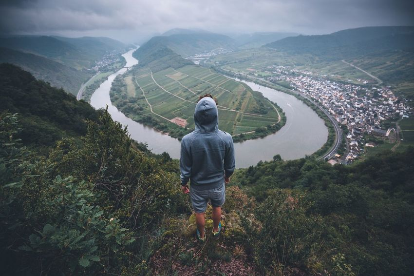 Stay outdoors. Mountain Nature Beauty In Nature Real People Landscape High Angle View Day One Person Scenics Rear View Lifestyles Full Length Outdoors Vacations Men Grass Sky People Moselschleife Germany