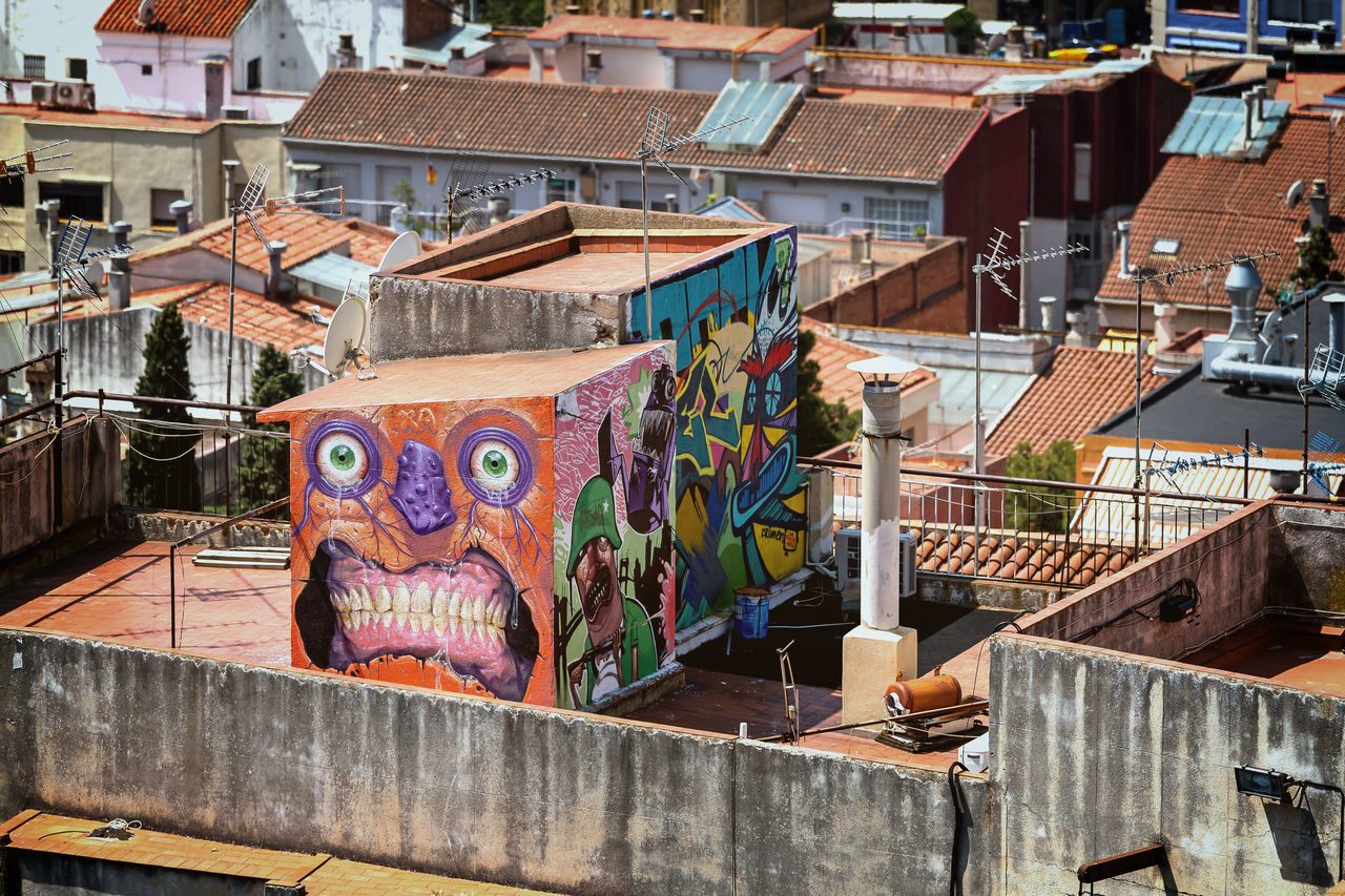 architecture, graffiti, built structure, building exterior, multi colored, outdoors, day, street art, no people, city
