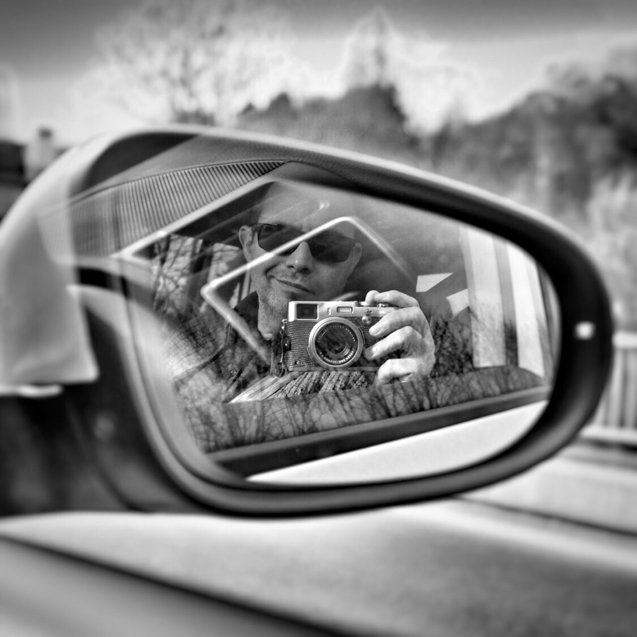 car, side-view mirror, transportation, mirror, mode of transport, land vehicle, reflection, photographing, camera - photographic equipment, one person, real people, outdoors, day, close-up, technology, digital single-lens reflex camera, sky