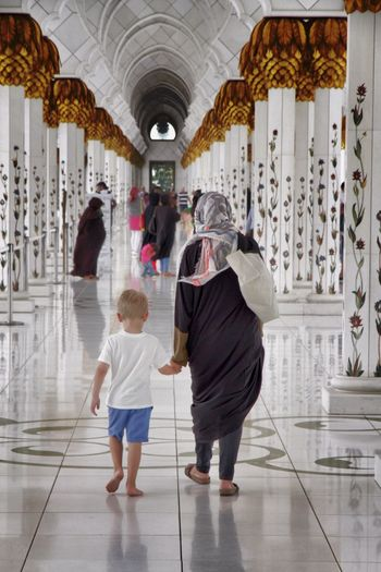 Abu Dhabi Adult Architecture Church Columns Day Full Length Grand Mosque Grand Mosque Abu Dhabi Indoors  Mother People Rear View Standing Togetherness Two People Women