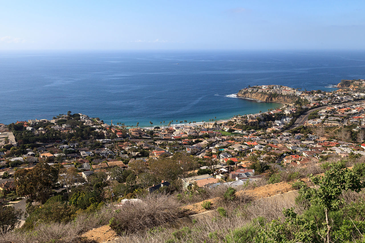 Coastline of Laguna Beach from an aerial view that shows Emerald Bay in Southern California, USA Aerial View Architecture California Coast City Cityscape Coastline Day Emerald Bay Horizon Over Water Laguna Beach, CA Nature No People Outdoors Scenics Sea Sky Tourism Town Travel Destinations