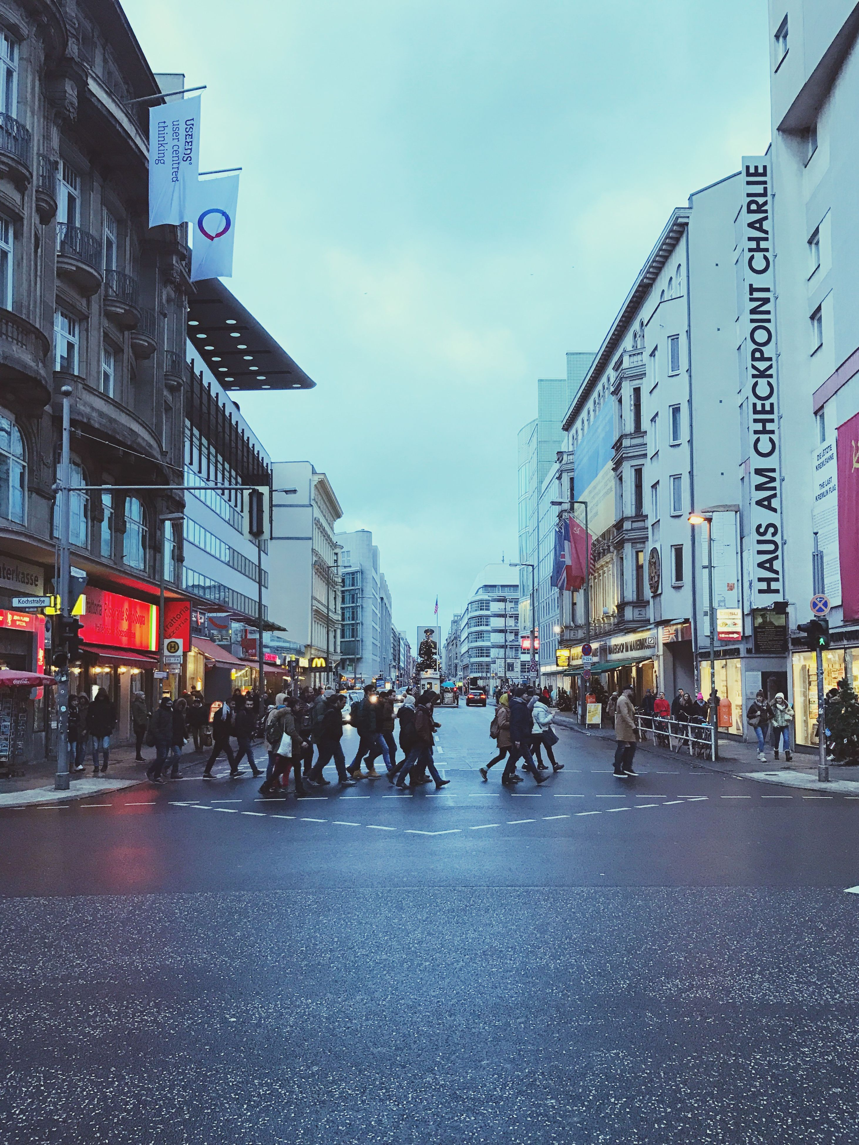 city, building exterior, street, built structure, city street, architecture, city life, outdoors, real people, large group of people, street scene, sky, road, day, people, adults only, adult