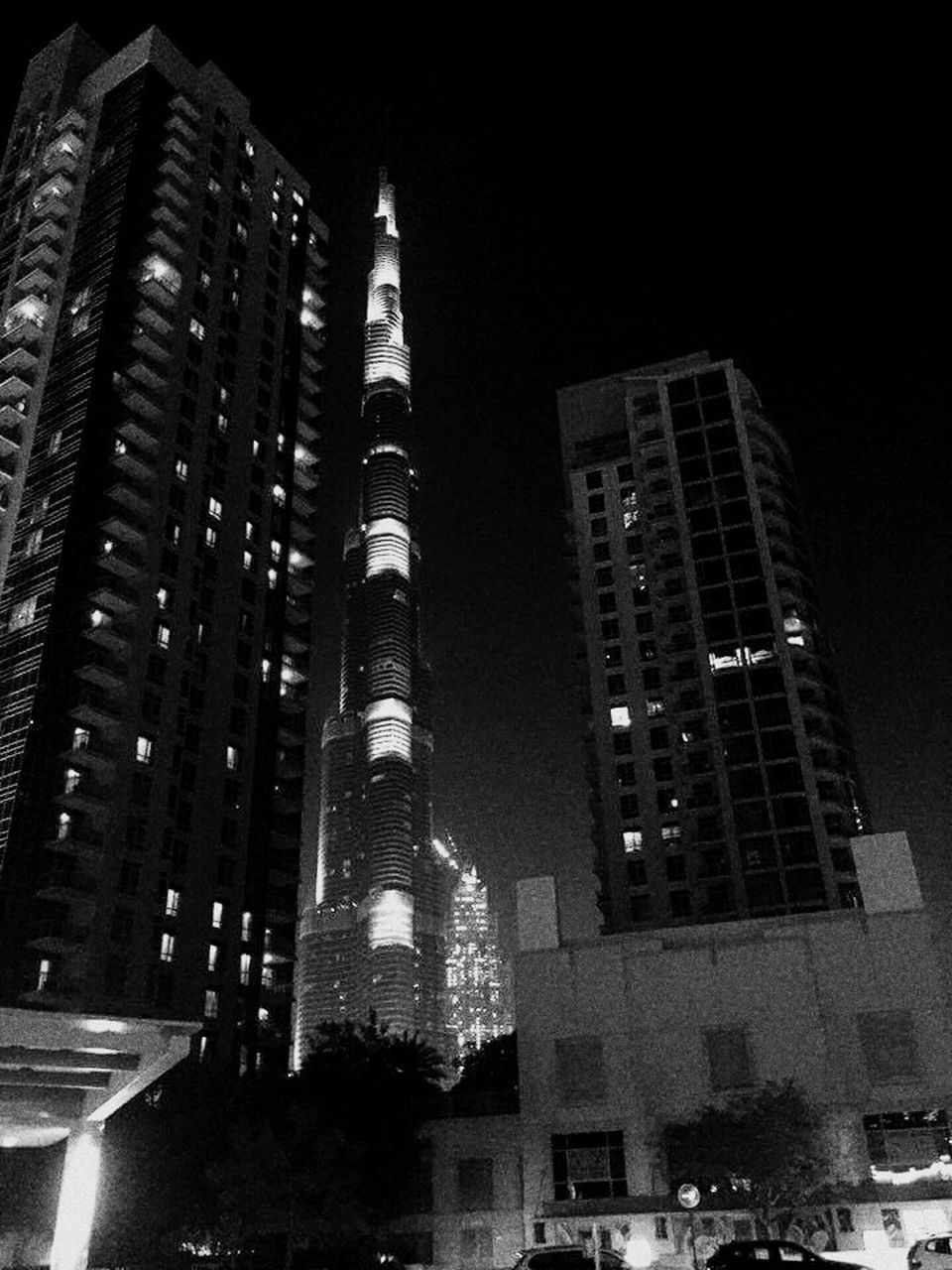 architecture, building exterior, night, built structure, city, illuminated, skyscraper, low angle view, no people, modern, outdoors, sky