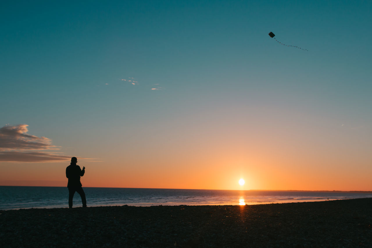 Beach Beauty In Nature Bluesky Colours Flying Horizon Over Water Kite Leisure Activity Nature One Man Only One Person Outdoors Pebbles On A Beach Scenics Sea Silhouette Silhouette Sky Sun Sunset Sunset Silhouettes Tranquil Scene Tranquility Water