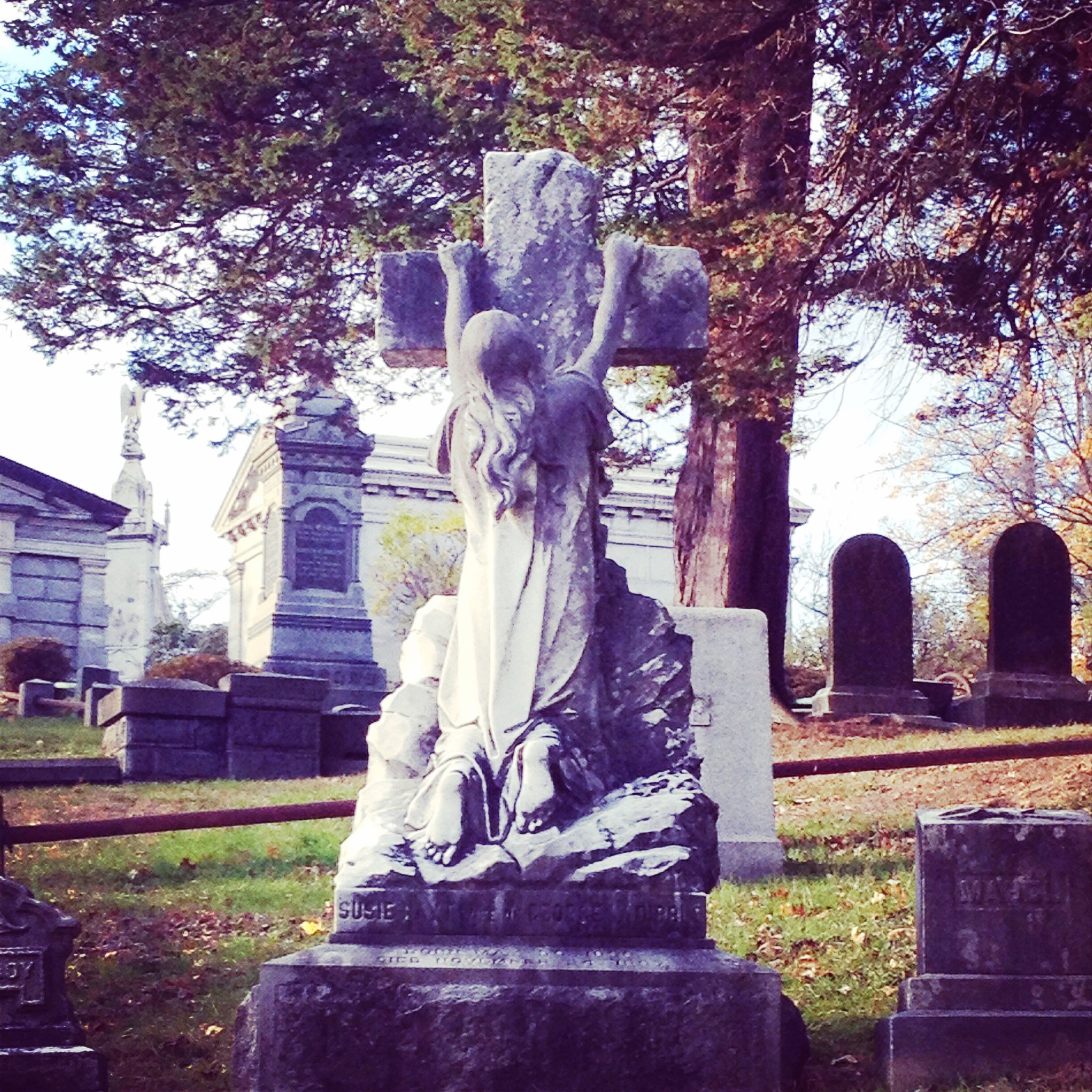 statue, human representation, sculpture, art and craft, art, creativity, architecture, built structure, tree, building exterior, religion, spirituality, cemetery, history, place of worship, tombstone, memorial