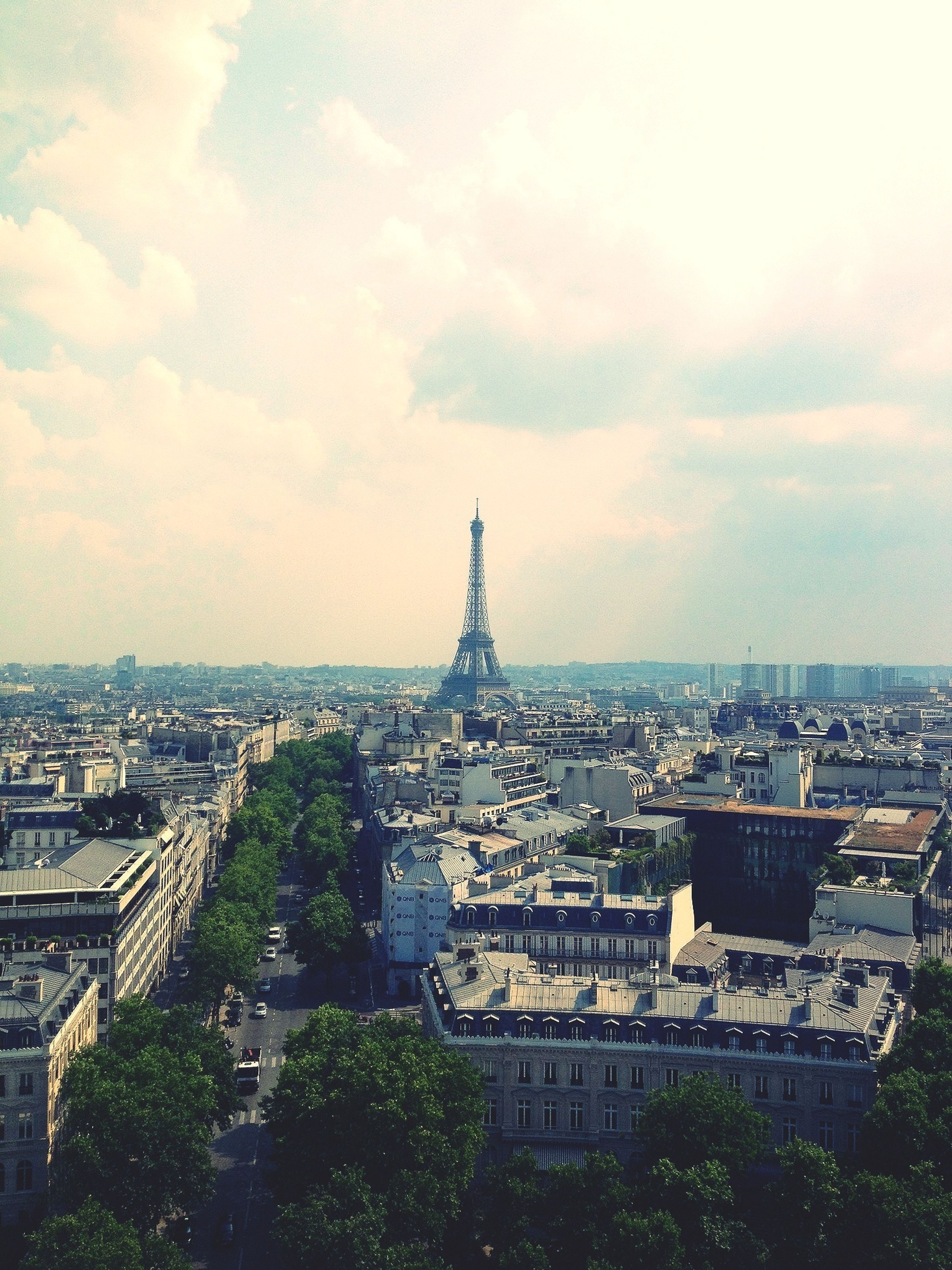 architecture, built structure, building exterior, cityscape, city, sky, crowded, capital cities, famous place, high angle view, travel destinations, tower, international landmark, eiffel tower, tall - high, tourism, travel, cloud - sky, residential district, city life