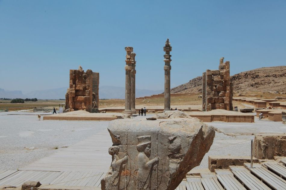 Miles Away Persepolis Persia Empire Iran Ancient History Architecture Built Structure Ancient Civilization Old Ruin Travel Destinations Tourism Clear Sky Archaeology No People Arid Climate Day Sky Outdoors Shiraz, Iran Sculpture Nature Statue Ancient History