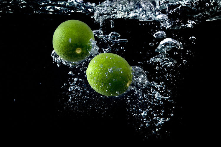 Lime splashing in the water Tropical Citrus  Food And Drink Green Raw Blacbackground Black Background Citron Citrus, Lime, Green, Ripe, Food, Fruit, Juicy, Isolated, Sour, Fresh, Slice, Closeup, Cut, Background, Raw, White, Organic, Half, Macro, Group, Vegetarian, Lemon, Section, One, Object, Round, Vitamin, Juice, Single, Healthy, Whole, Tropical, Studio, Segme Drop Food Freshness Fruit Green Color Juicy Lime Lime Isolated Object Ripe Round Sliced Sliced Fruit Studio Shot Vitamin Water first eyeem photo