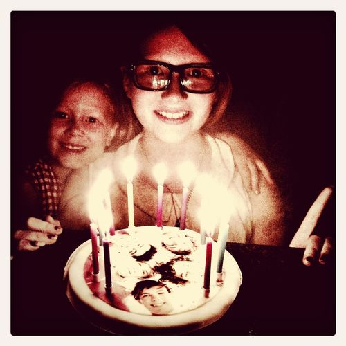 Summertime Cornwall Mulhollands Birthday girl Kitty (12) and sis Penny with the 1D cake...