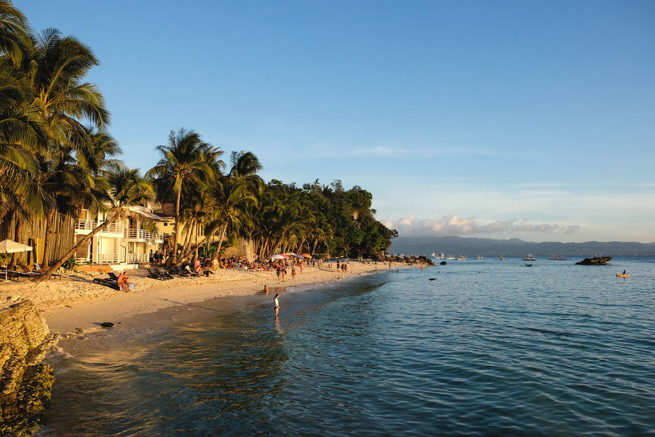 Backpacking Beauty In Nature Boracay Idyllic Outdoors Palm Trees Philippines Scenics Sky Sunset Tourism Tranquil Scene Travel Destinations Wanderlust Water