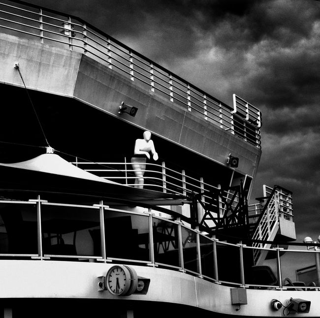 Faceless passage of time Architecture Artistic Expression Black And White Building Exterior Built Structure Clock Face Cloud - Sky Dark Clouds Day Development Film Is Not Dead Film Noir Film Style Low Key No People Outdoors Railing Sculpture Ships Balconey Sky Steps And Staircases Still Life Photography Transportation Veiw From The Top