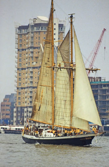 Architecture Water Sky Sailing Day Outdoors Transportation Sailboat Sailing Ship Tall Ships Race Tall Ship Mast No People Nautical Vessel Building Exterior Built Structure Training Ship Yellow Oilskins Boys In Rigging Postcode Postcards